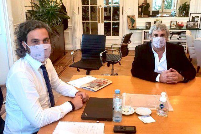 Santiago Cafiero y Sergio Romero